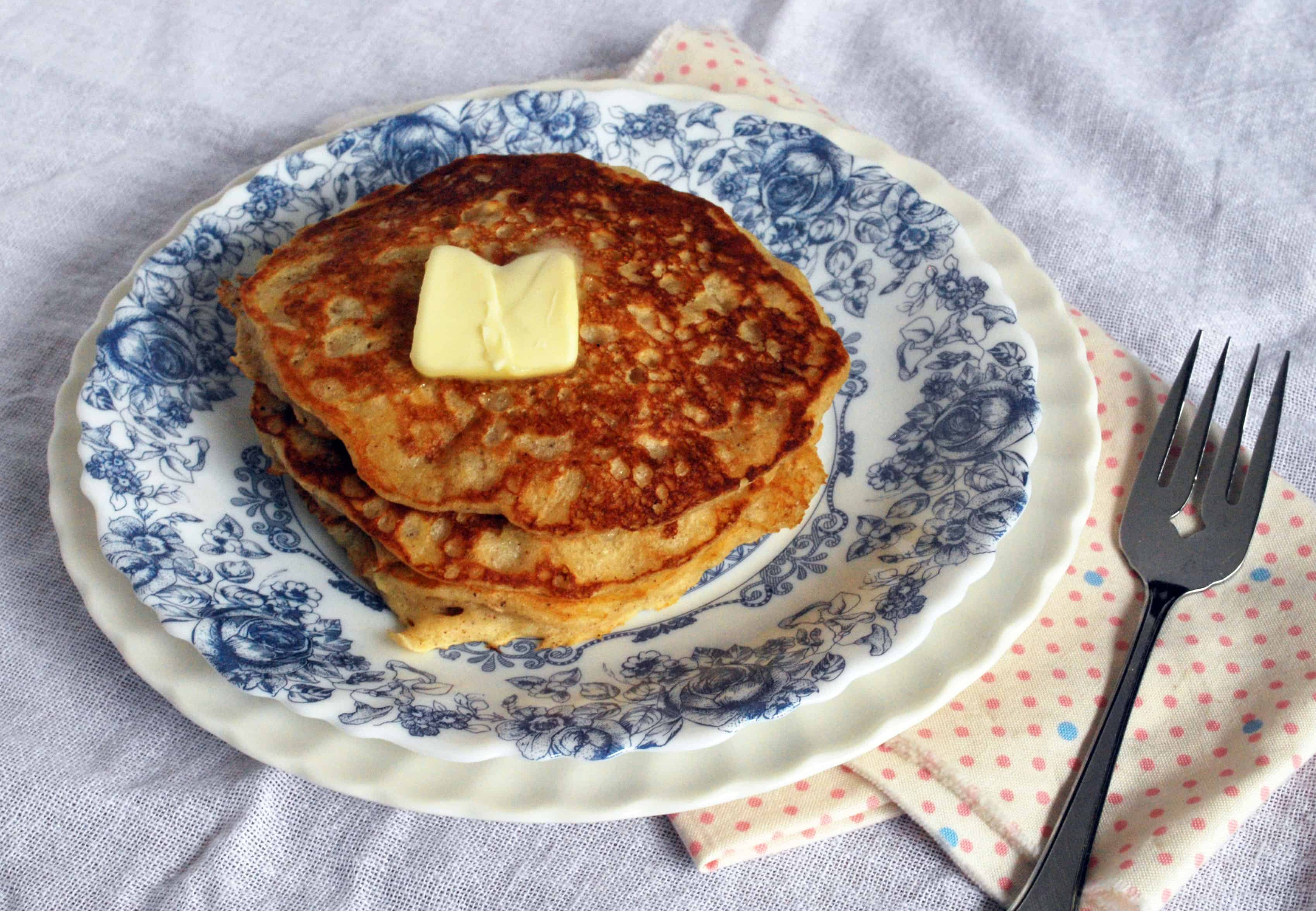 Oatmeal Cookie Pancakes on a plate with a napkin and fork