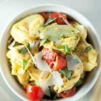 Pesto Tortellini Salad - This is my favorite pasta salad! It's the perfect vegetarian dish to bring to summer picnics and potlucks. Full recipe at theliveinkitchen.com