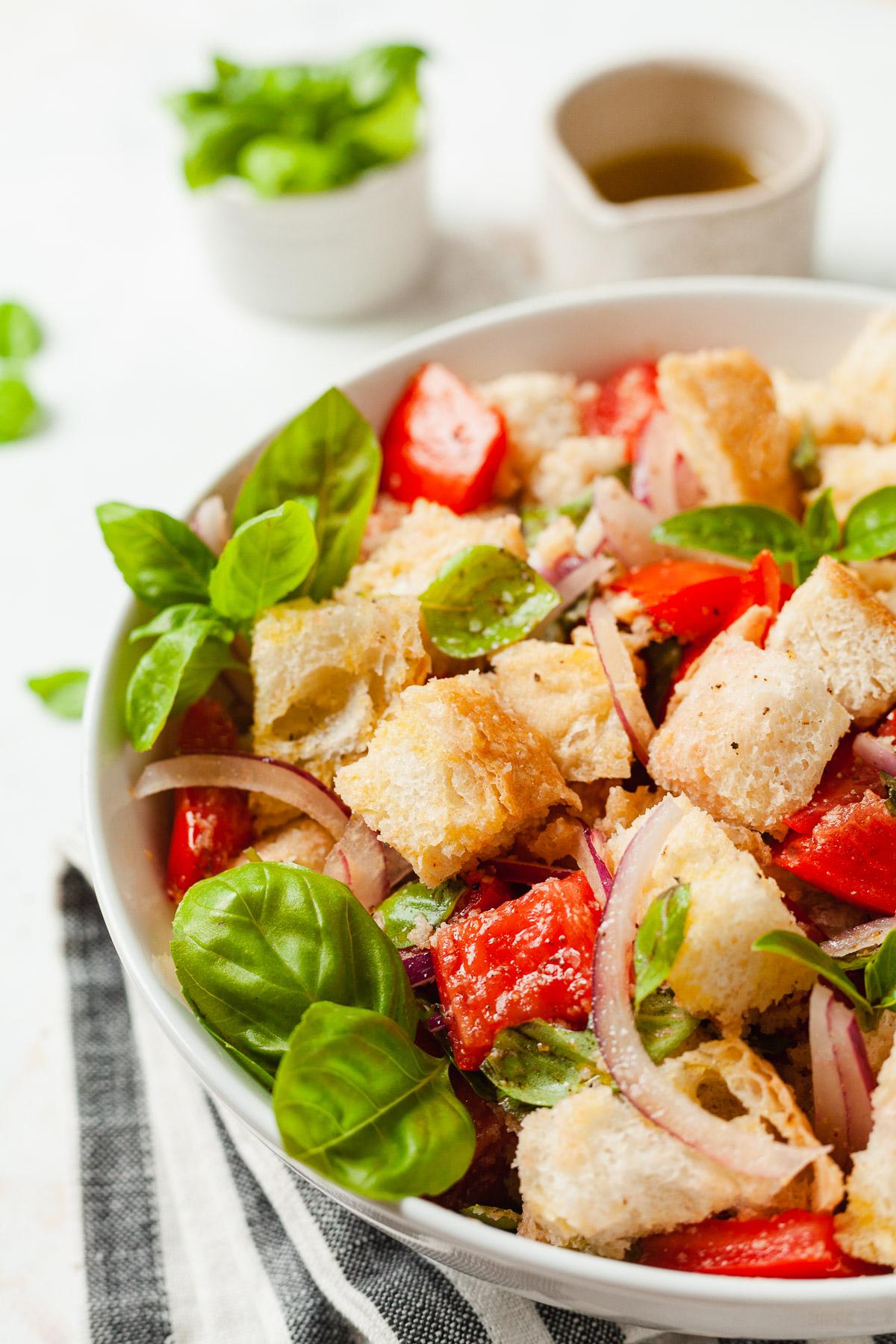 a bowl of vegan panzanella salad