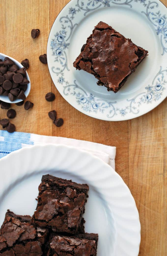 a brownie on a plate with chocolate chips