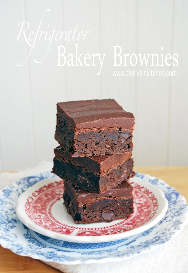 a stack of three cold chocolate brownies on two stacked plates