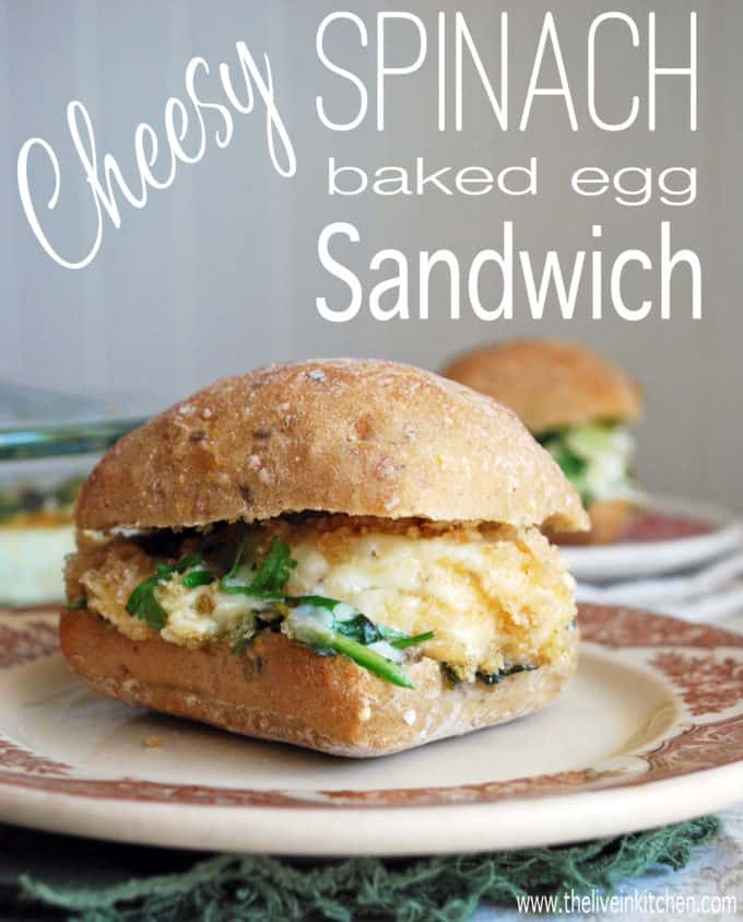 an egg sandwich with cheese and spinach
