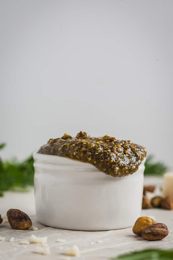 pistachio pesto overflowing a white cup
