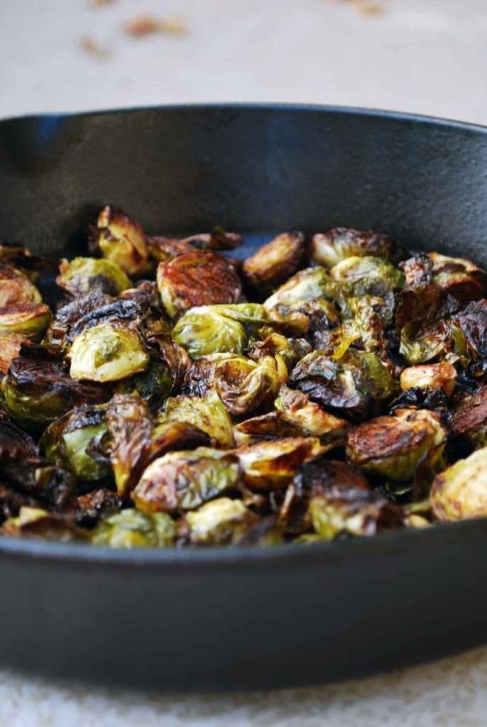 balsamic roasted brussels sprouts in a cast iron pan