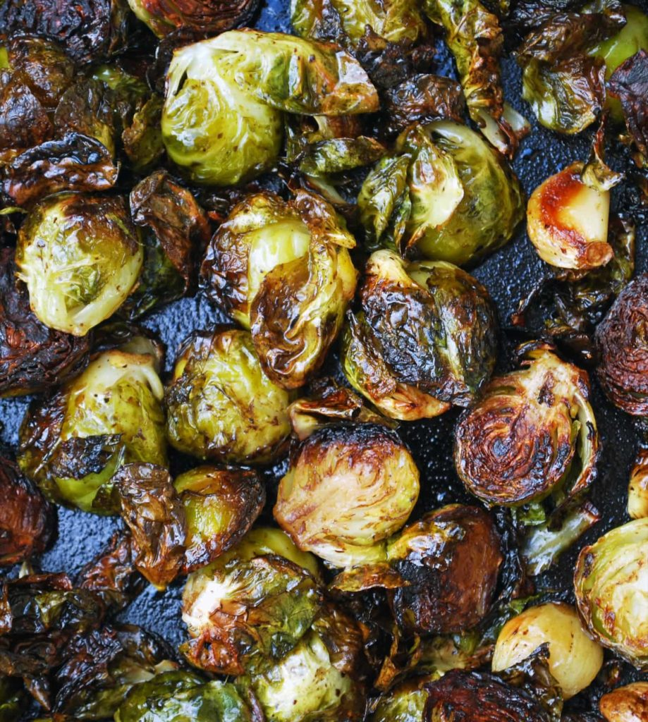 balsamic roasted brussels sprouts and garlic in a cast iron pan