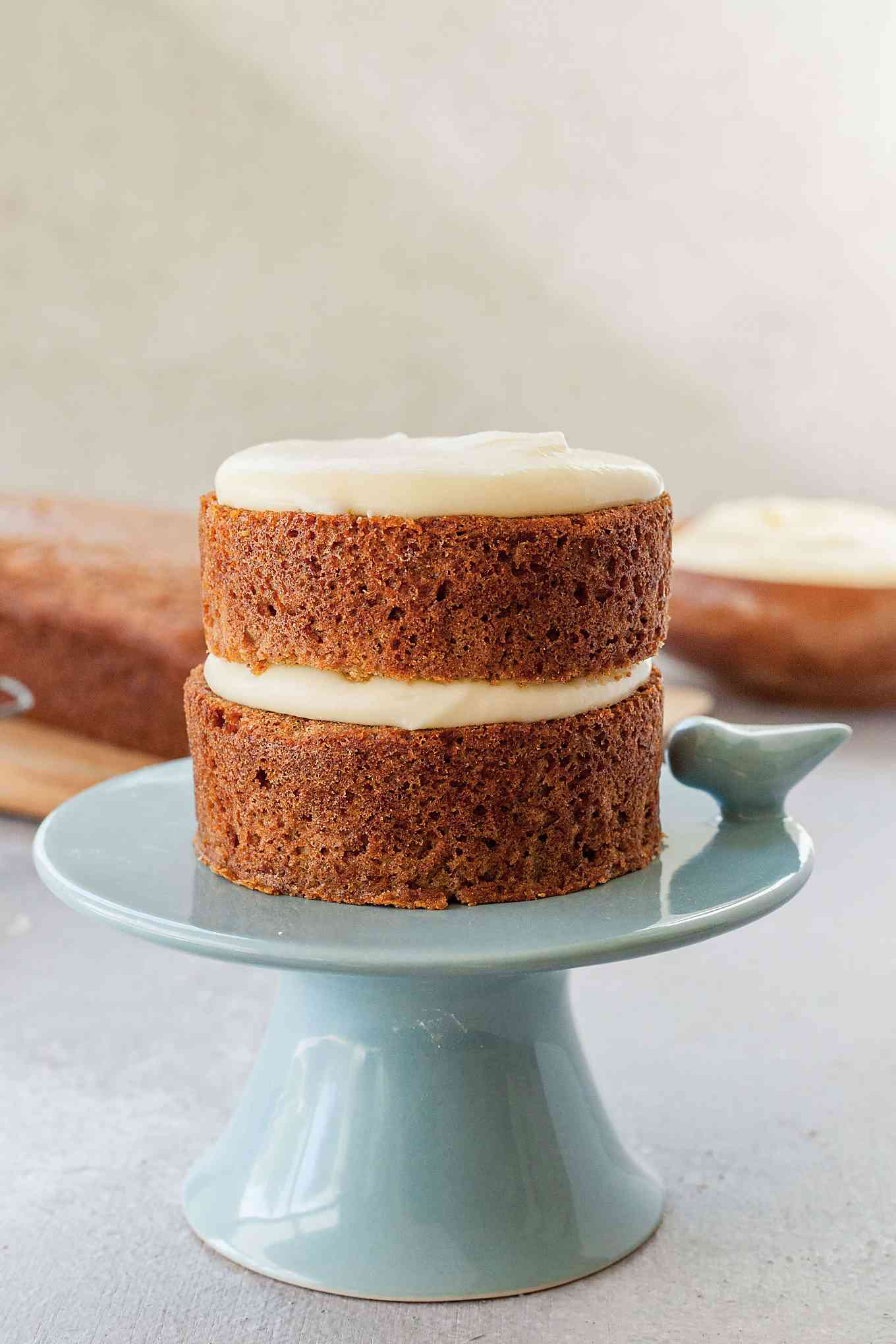 image of applesauce cake on top of blue cake stand
