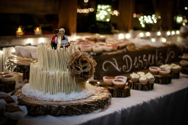 Two-Tiered Chocolate Cheesecake - super decadent, covered in caramel, shredded coconut, and white chocolate cigarettes. A different kind of wedding cake!