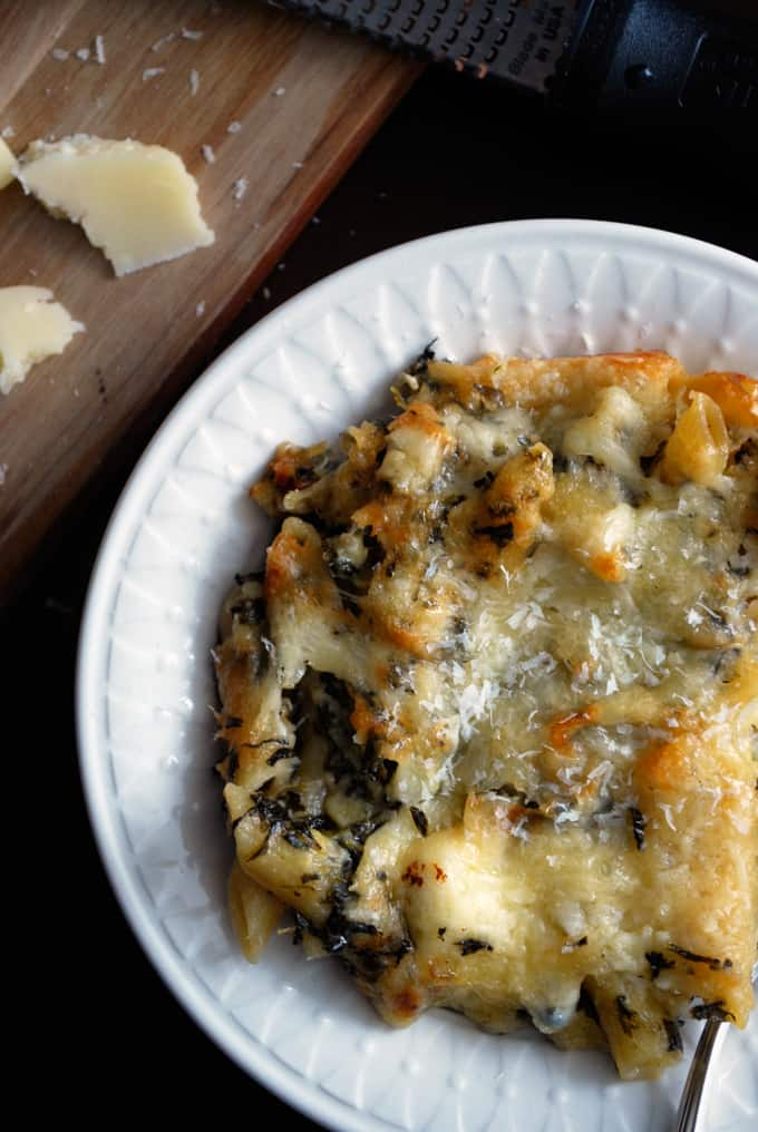 a bowl of spinach artichoke mac and cheese