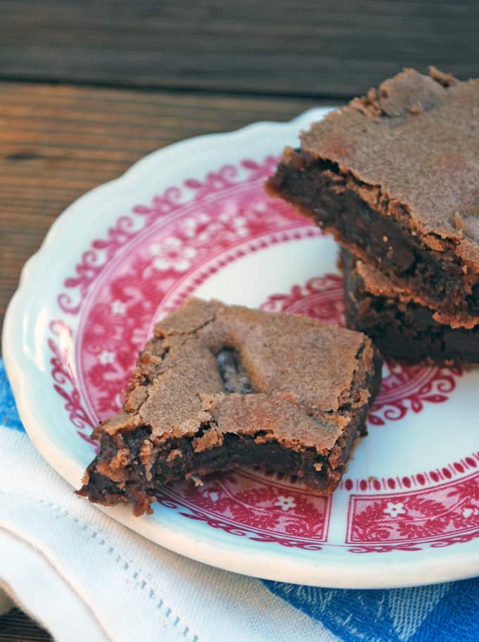 several brownies on a pink and white plate