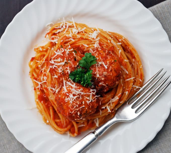 a plate of spaghetti and vegetarian meatballs