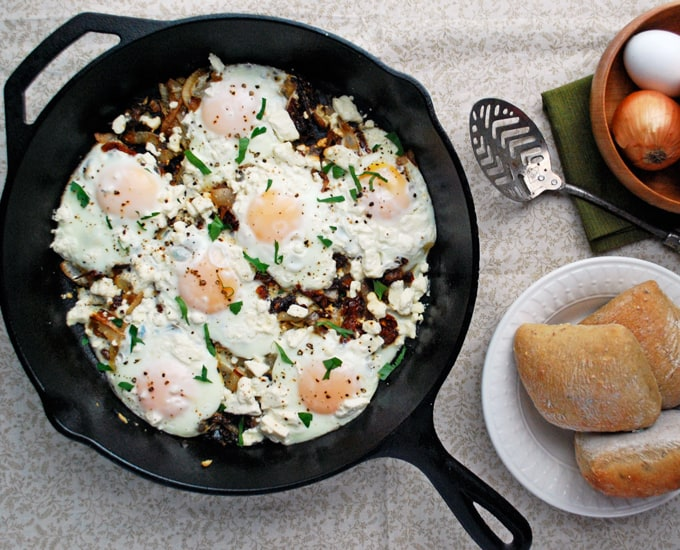Mediterranean Eggs - Caramelized onions, sun dried tomatoes, eggs, and feta make a flavorful breakfast for dinner! Full recipe at www.theliveinkitchen.com