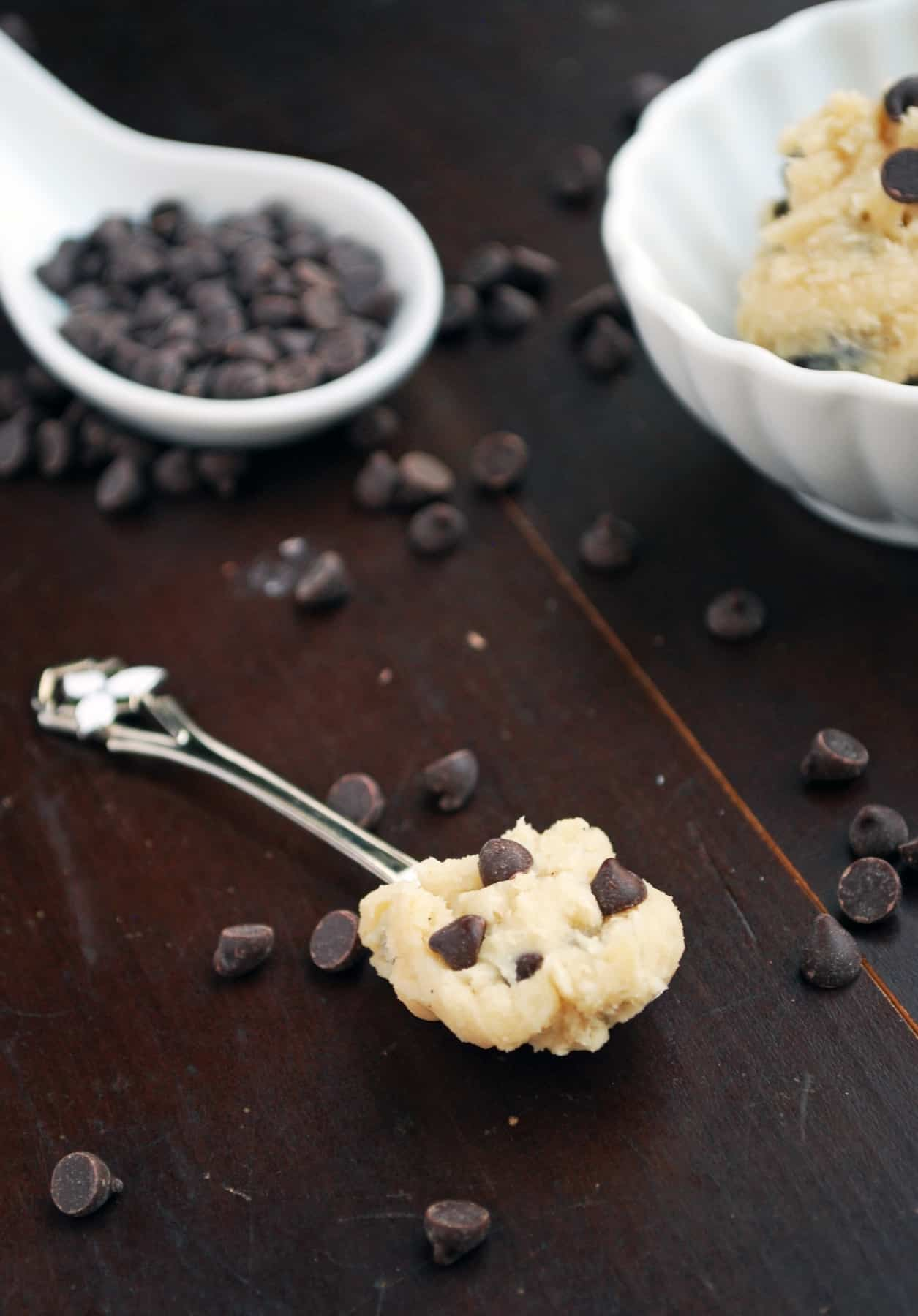 vegan cookie dough on a spoon with chocolate chips