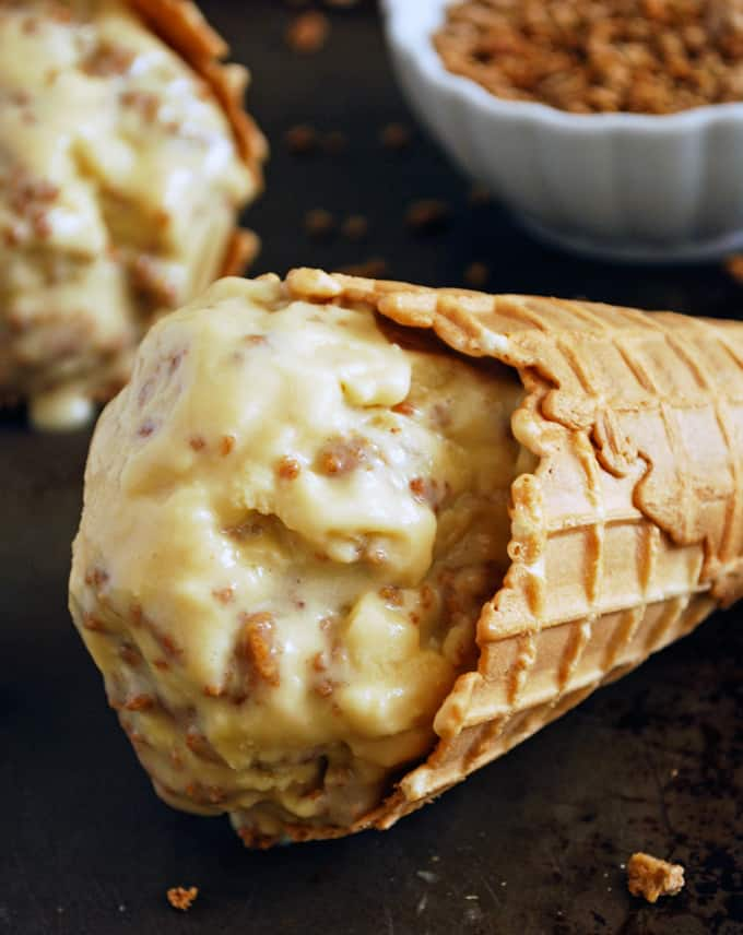 close up of brown sugar ice cream with honey grape nut crunch in a waffle cone