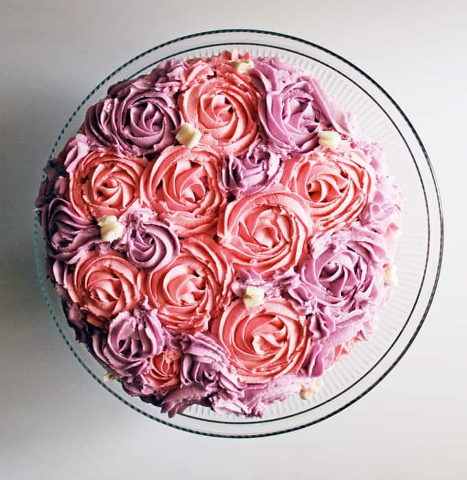 Pink and purple rose cake with white butterflies, perfect for a little girl's birthday! www.theliveinkitchen.com