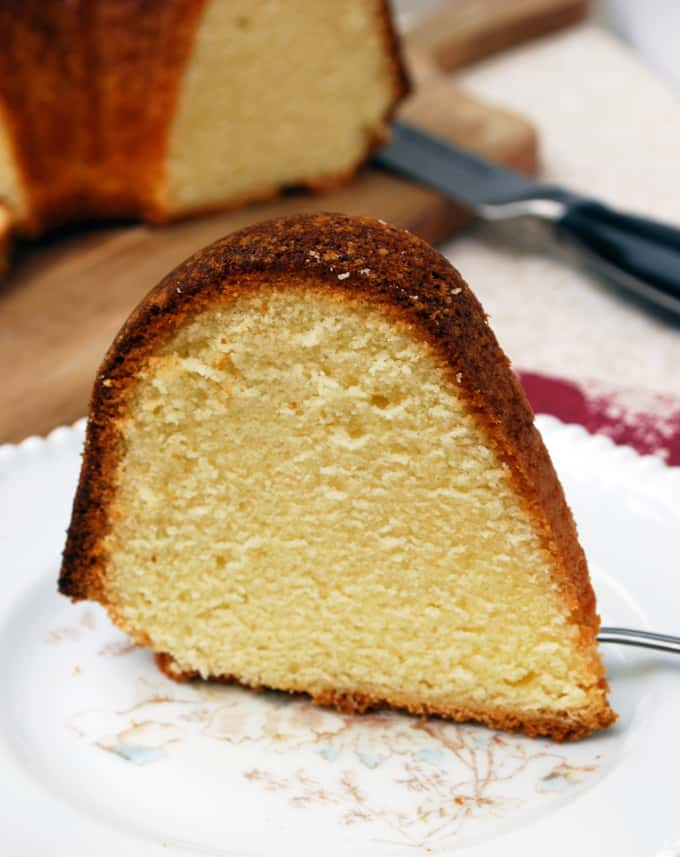 image of lemon pound cake slice standing on plate