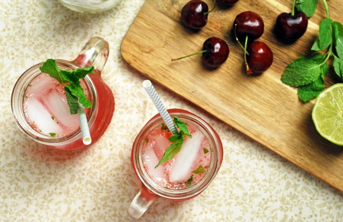 cherry mojitos with mint and straws