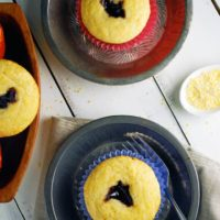 Black Raspberry Cornbread Muffins - Sweet, moist, and fluffy cornbread muffins with a black raspberry jam center!