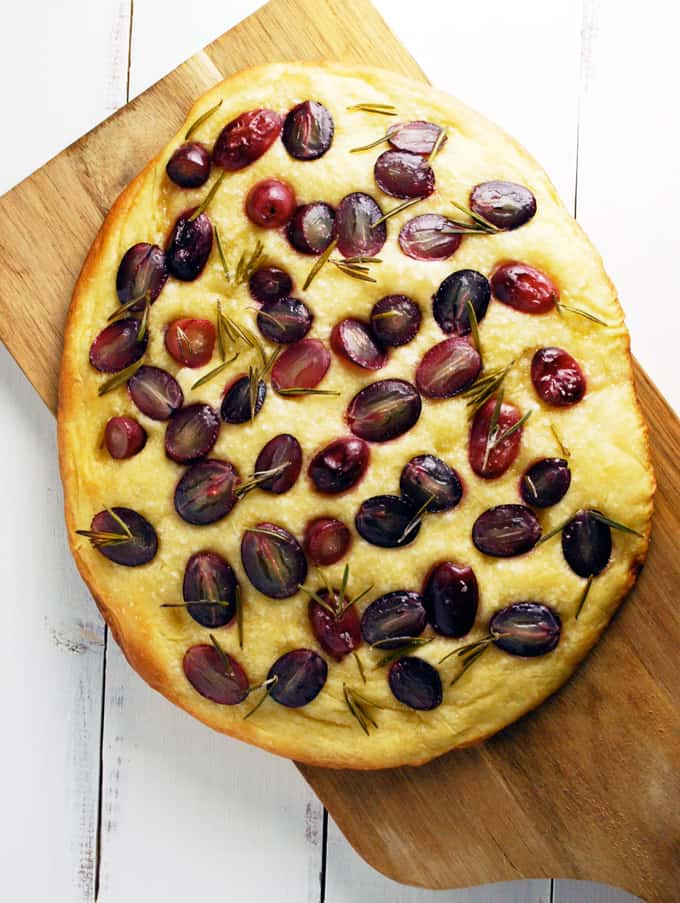 focaccia topped with rosemary and grapes