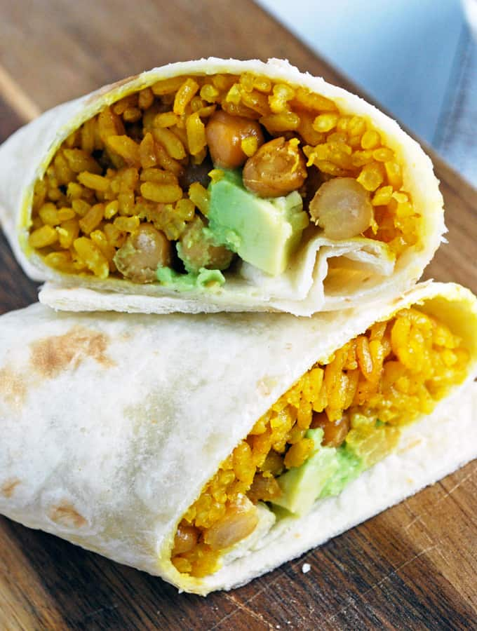 Avocado, Yellow Rice, and Roasted Chickpea Burritos - These are so savory! A great way to change up burritos.