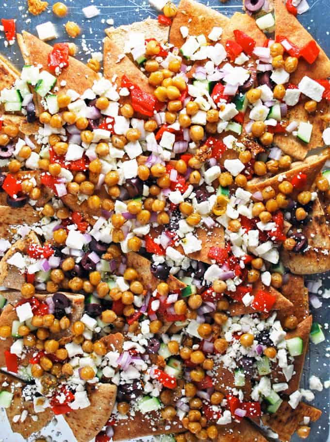 a sheet pan filled with greek nachos