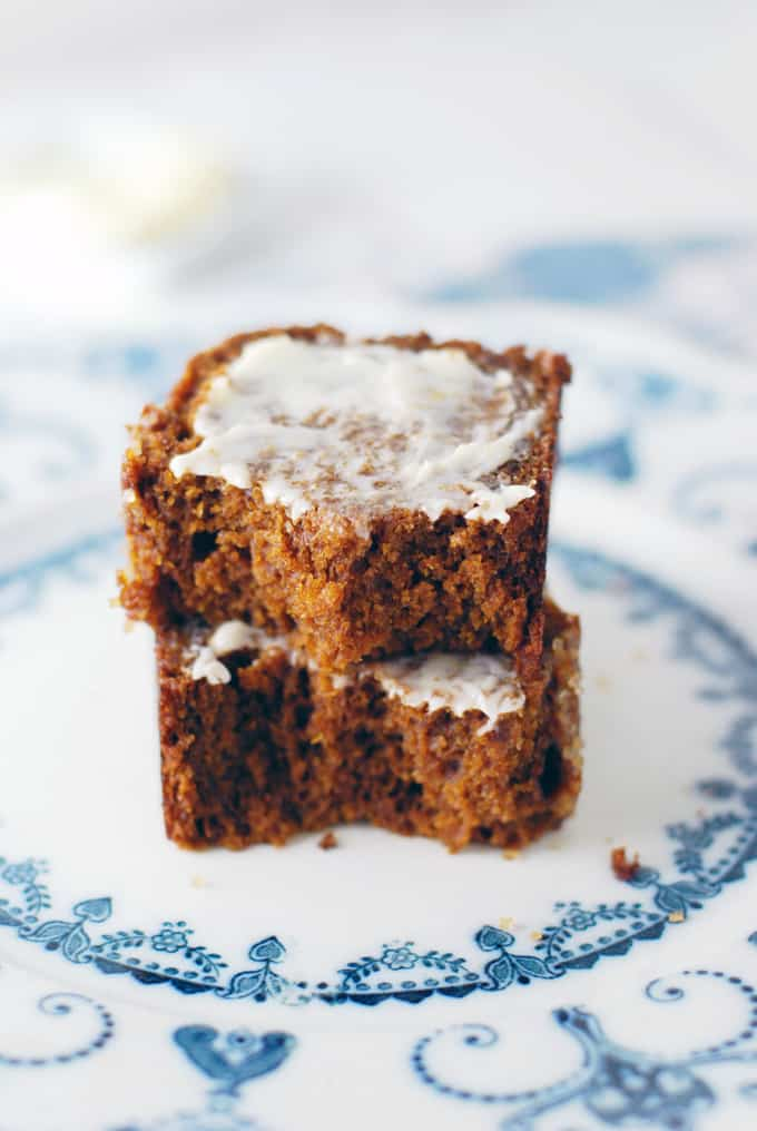 two slices of buttered pumpkin gingerbread cake