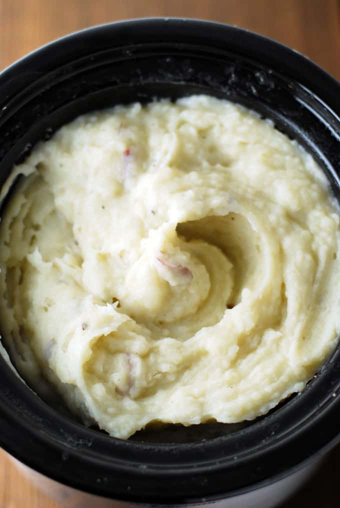 Cheesy Crock Pot Mashed Potatoes - These are the easiest mashed potatoes you'll ever make, and the gruyere cheese makes them to die for! Full recipe at theliveinkitchen.com