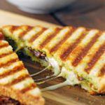 a pesto grilled cheese cut in half