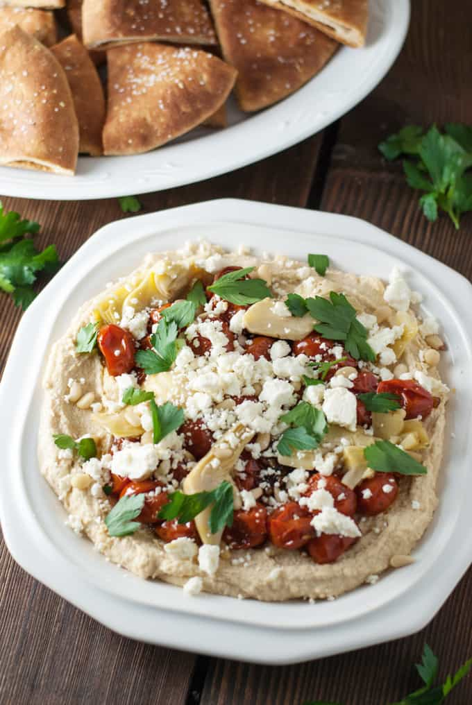 Loaded Hummus - This hummus is so beautiful and full of flavor! It makes a great appetizer or even dinner! Full recipe at theliveinkitchen.com