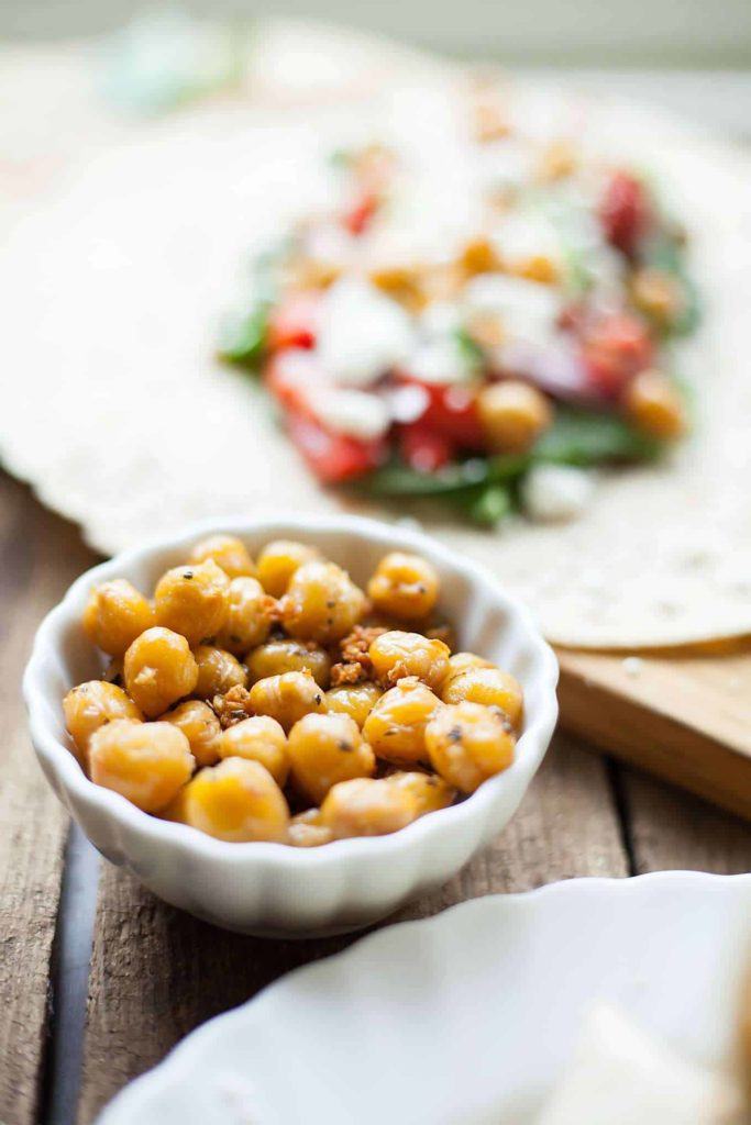Greek Chickpea Wraps - This easy sandwich is filled with roasted chickpeas, crunchy veggies, and tangy feta cheese! I love taking these on the go. theliveinkitchen.com