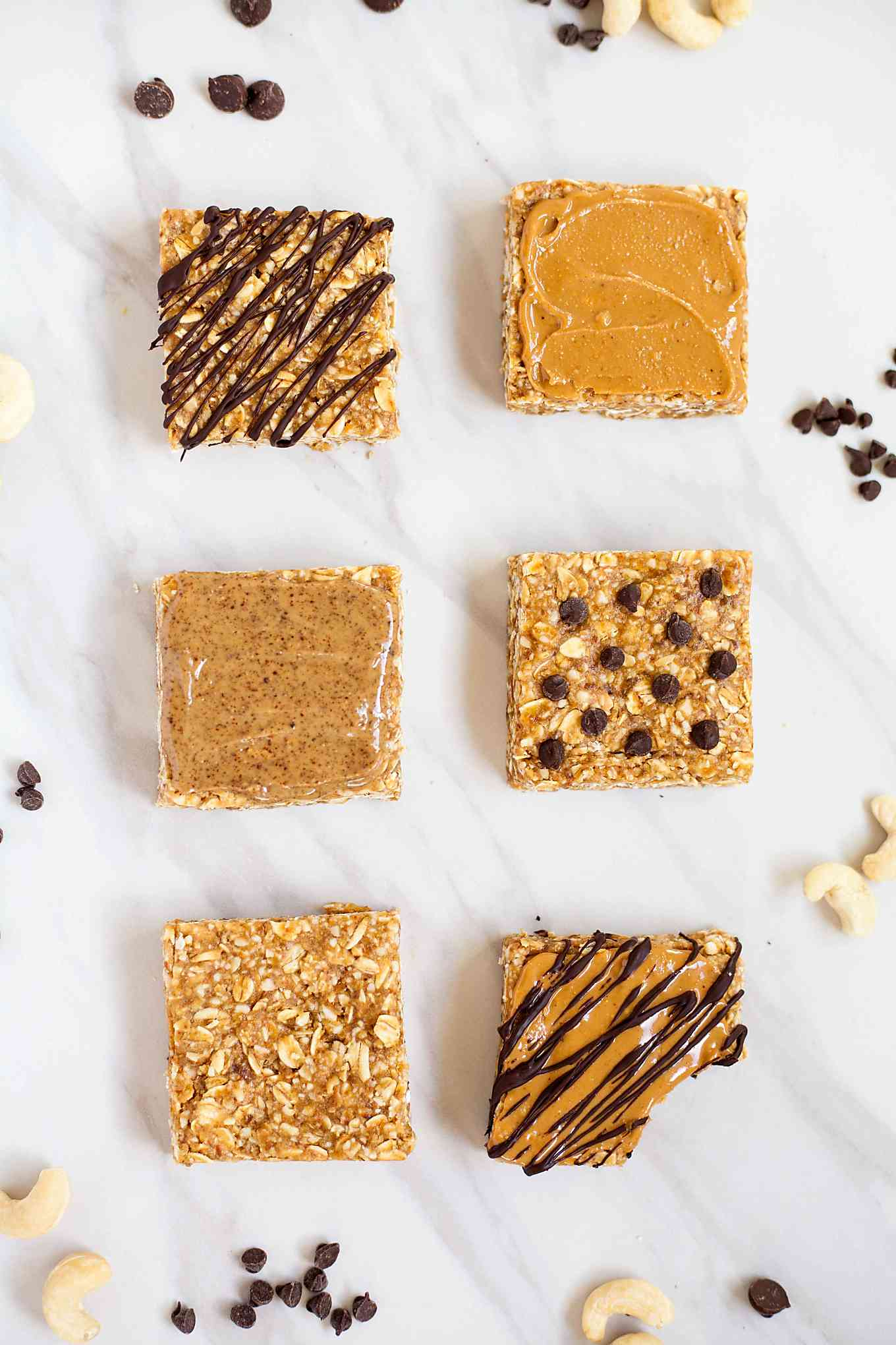 six cashew butter granola bars with one bite taken out of one