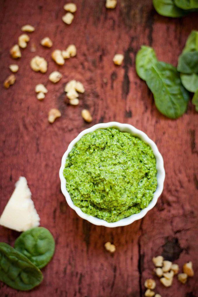 spinach pesto in a small white bowl