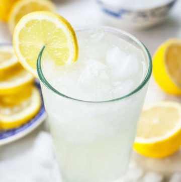 single serving lemonade in a glass with lemons