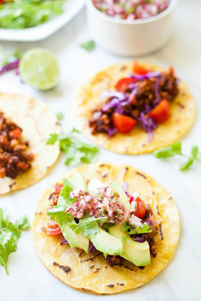 Vegan Tempeh Tacos - These are the ultimate vegan taco! Meaty tempeh, fresh veggies, and crisp shells. I can't stop eating these! 30 minutes, easy and fast! theliveinkitchen.com