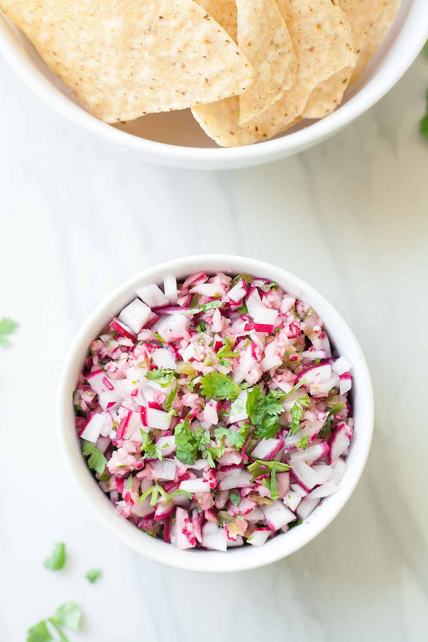 a bowl of radish salsa and a bowl of tortilla chips