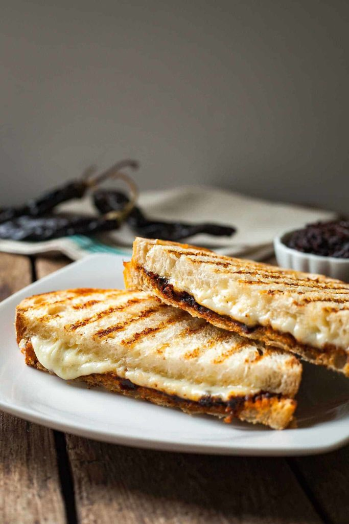 a harissa grilled cheese sandwich on a white plate