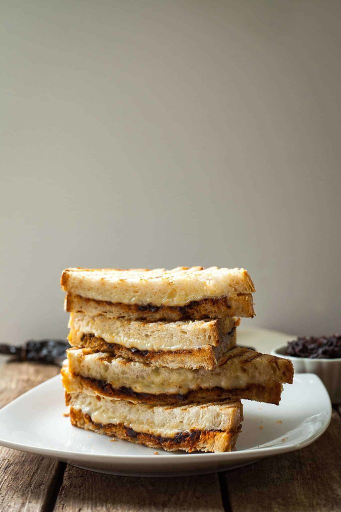 a stack of halved harissa grilled cheese sandwiches