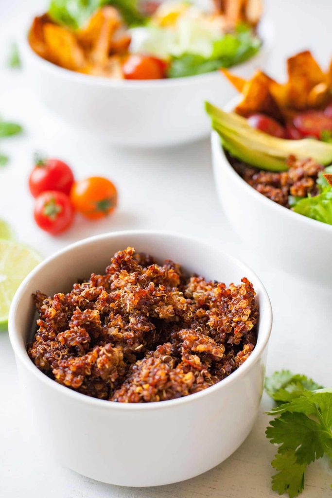 Quinoa Taco Salad - This is the tastiest way to eat all the veggies! This vegetarian bowl is given a spicy kick with the addition of quinoa taco meat! Recipe at theliveinkitchen.com