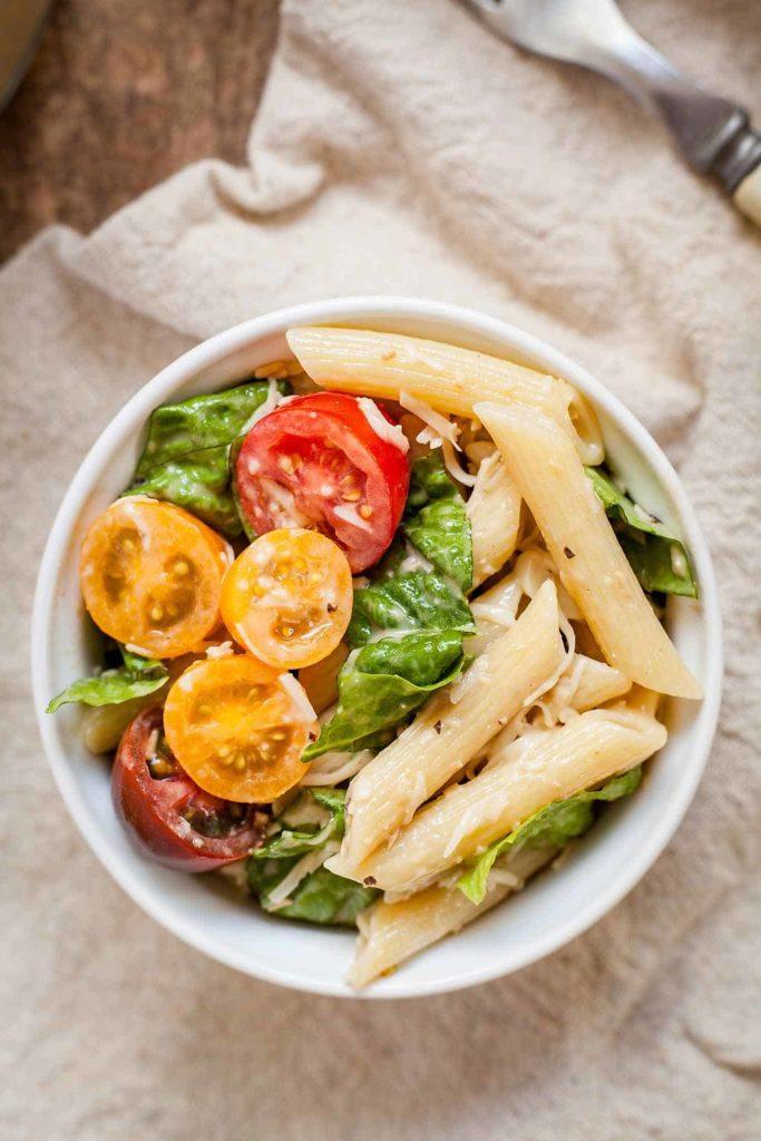 a small bowl of caesar pasta salad