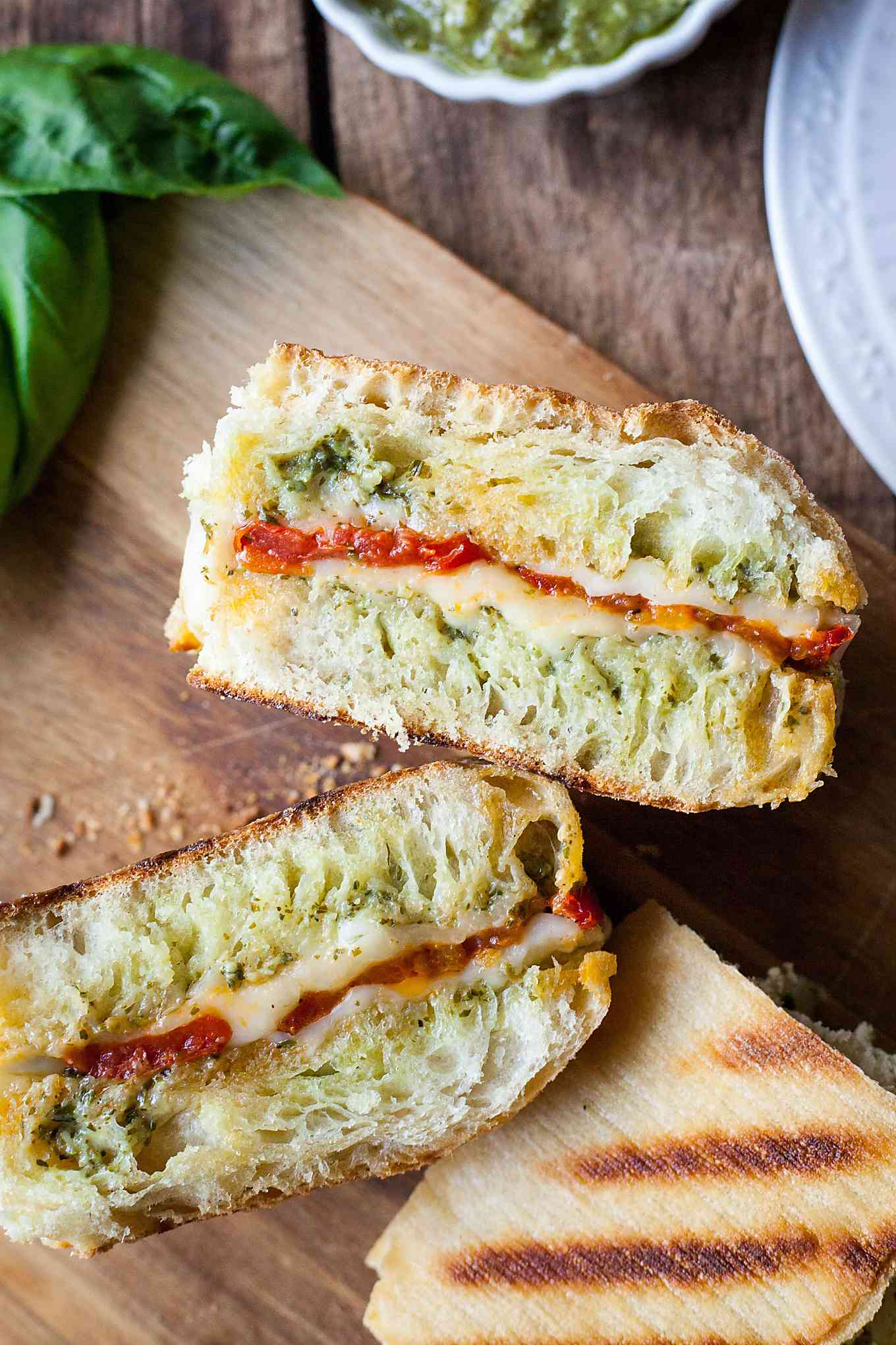 a pesto panini cut in half