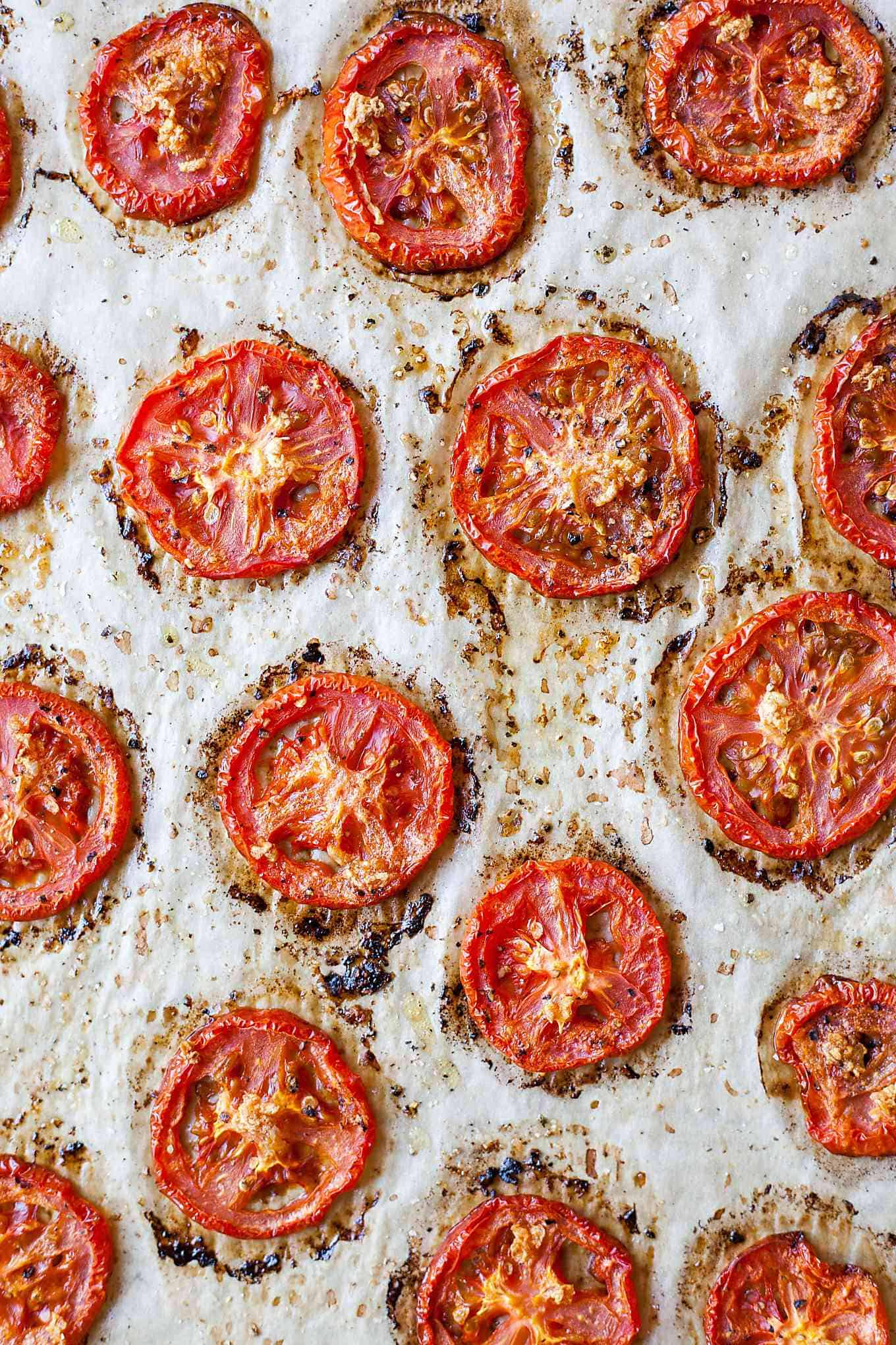oven roasted tomatoes on a baking sheet lined with parchment paper