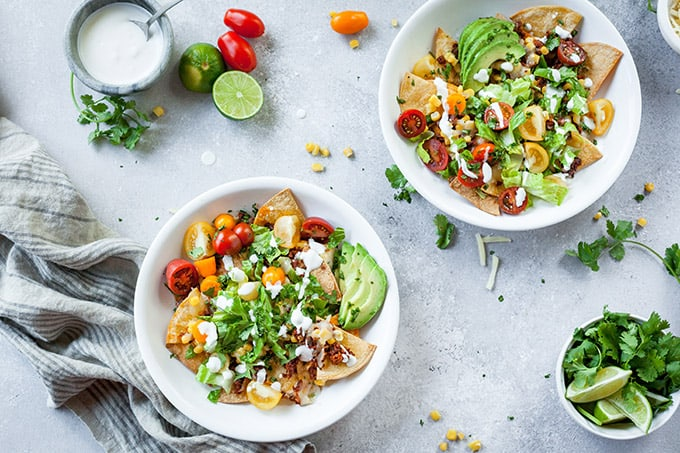 image of bowls with vegetarian chorizo nachos with lime crema