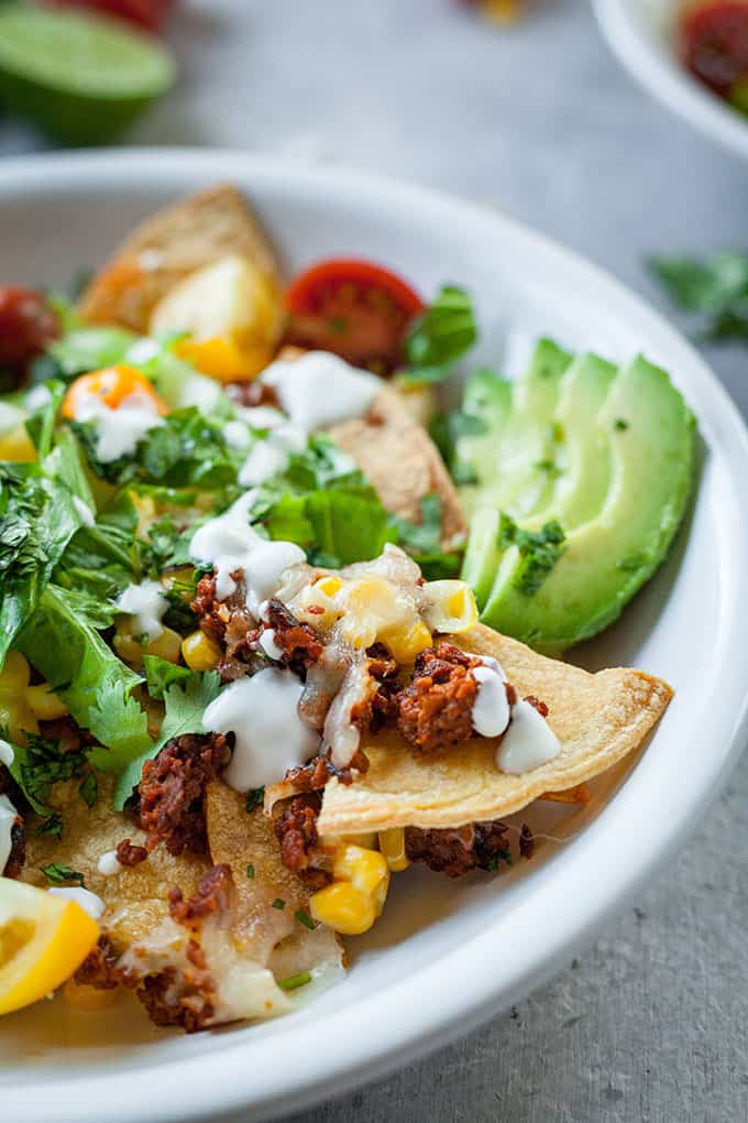 close up image of chorizo nachos on plate