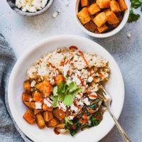 overhead photo of a sweet potato buddha bowl with a bowl of sweet potato chunks