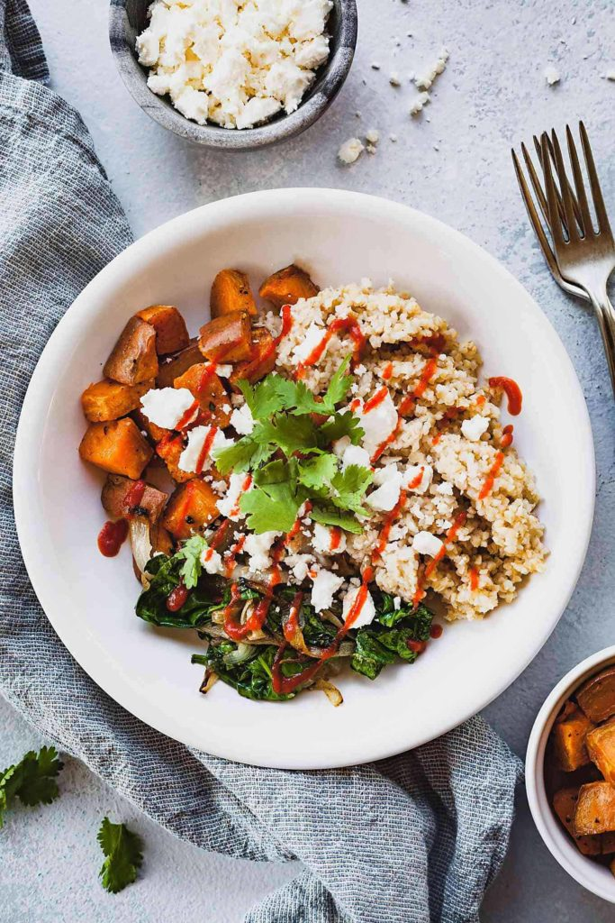 Roasted Sweet Potato Bulgur in white bowl with two forks on sidel