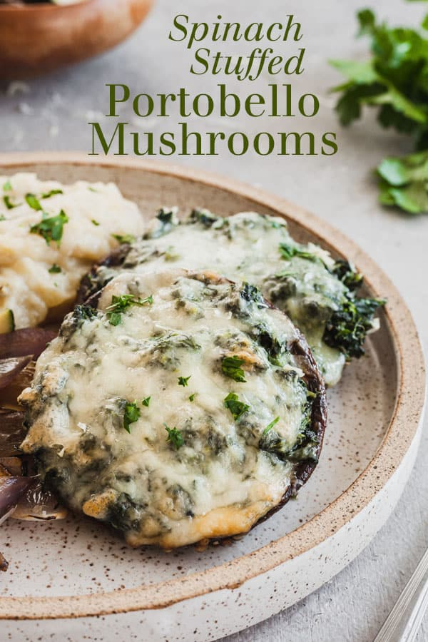 Spinach Stuffed Portobello Mushrooms - An easy vegetarian dinner that pairs well with mashed potatoes and other sides! Creamy spinach and gooey cheese in a hearty portobello mushroom. #mushrooms #mushroom #portobello #vegetarian #easyrecipe #cheese #meatless