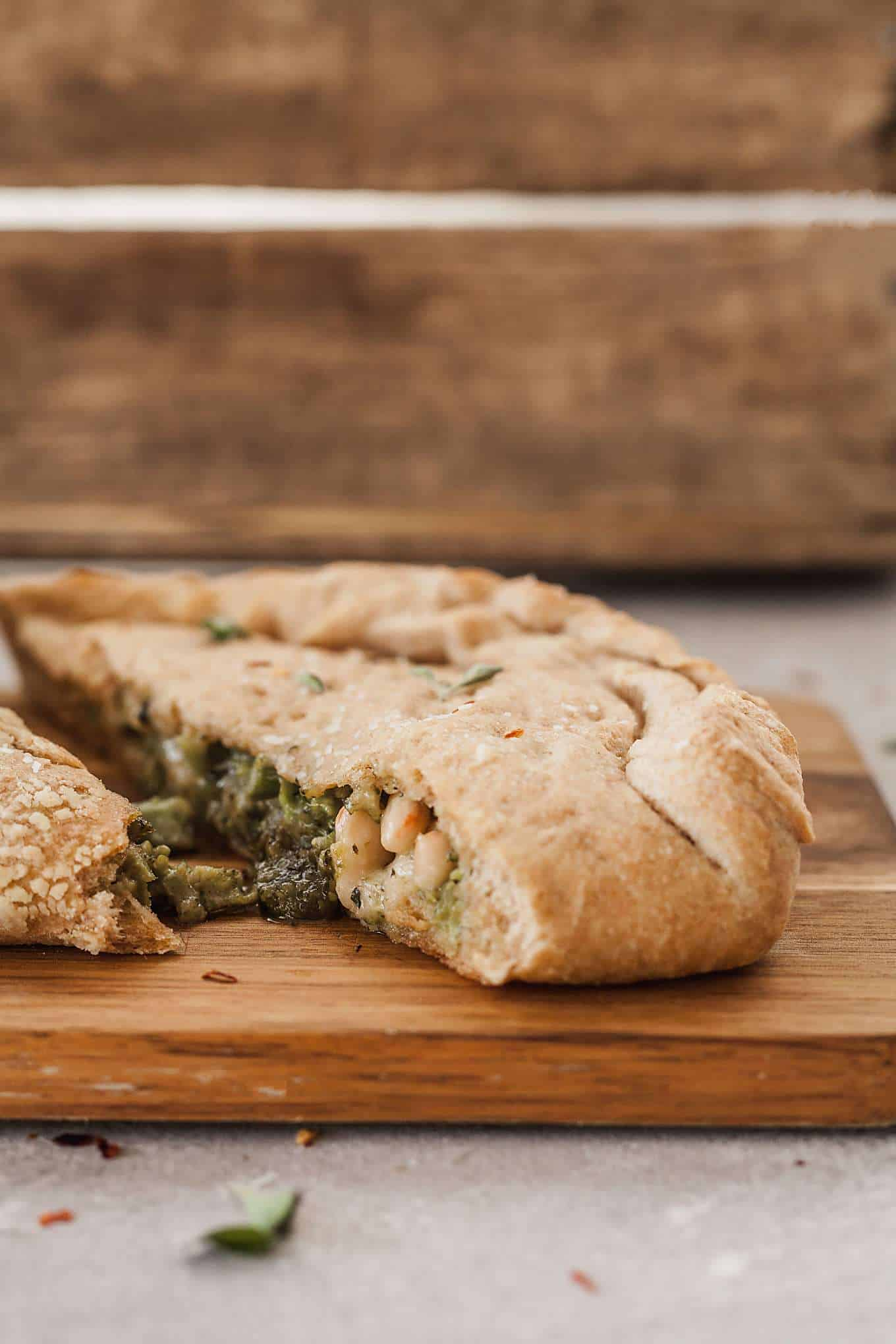 side view image of vegetarian calzone on cutting board