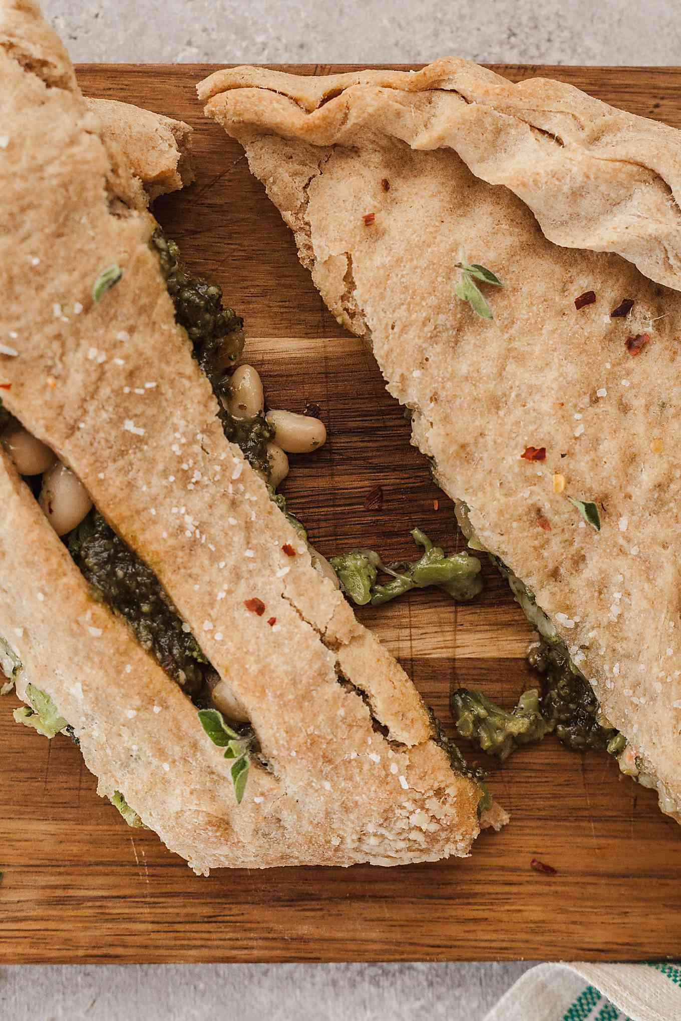 top image of vegetarian calzone split apart