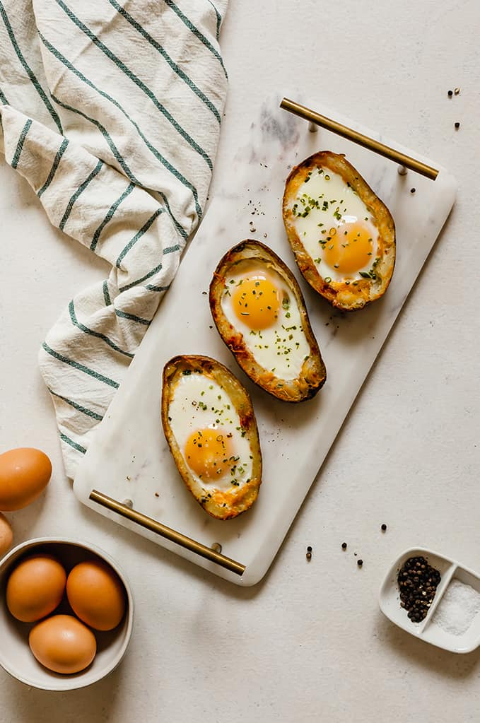 top view of marble tray with potato skin egg boats