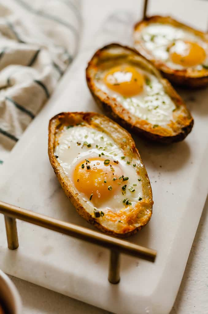 side view of potato egg boats on marble tray