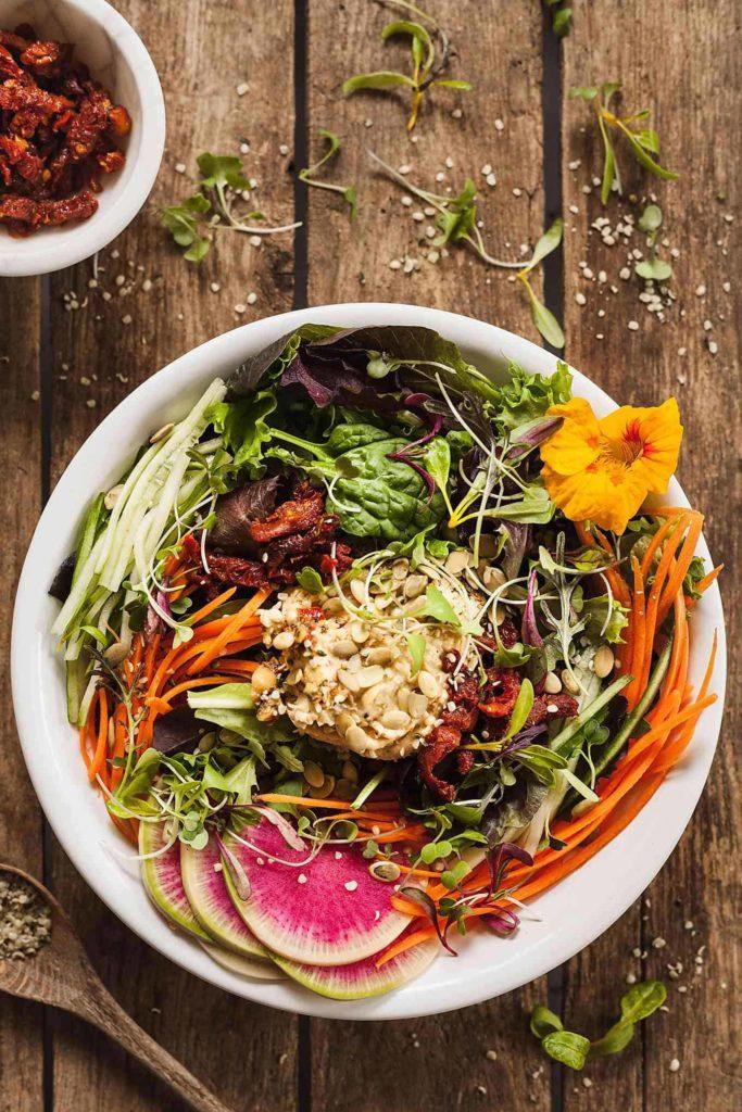 image of protein vegan salad in large white bowl